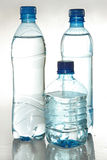 Three plastic bottles with potable water Stock Image