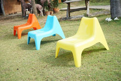 Three plastic chair in garden Royalty Free Stock Photography