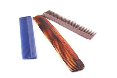 Three plastic color combs Stock Images