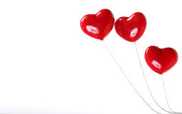 Three plastic hearts. Three plastic Valentine hearts on white background Royalty Free Stock Photo