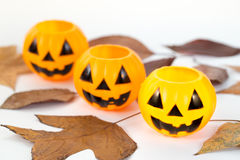 Three plastic pumpkins with leafs Royalty Free Stock Images