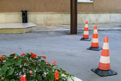 Three plastic signal road cones. Restricting access to the house stock image