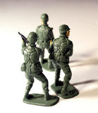 Three plastic soldiers from the Rear. 3 green plastic toy soldiers back view on white background royalty free stock images