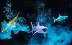 Three Plastic Toy Fish Underwater royalty free stock photos