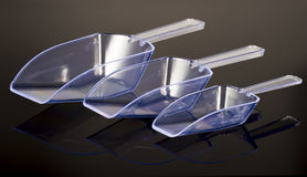 Three plastic transparent scoops Stock Photos
