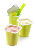 Three plastic yogurt pots Royalty Free Stock Image