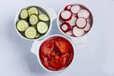 Three plate with red tomatoes, green cucumber and  Royalty Free Stock Photography