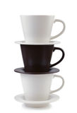 Three plates and coffee cups stacked together Royalty Free Stock Photos