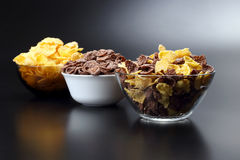 Three plates with different corn flakes Stock Photo