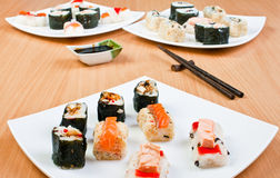 Three plates of sushi Royalty Free Stock Images