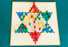 Three-player gameboard of Diamond Game on table. Three-player gameboard of Diamond Game variant of Chinese Checkers , variation of Halma strategy board game on royalty free stock photo