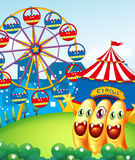 Three playful monster at the hilltop with a carnival. Illustration of the three playful monster at the hilltop with a carnival Stock Photography