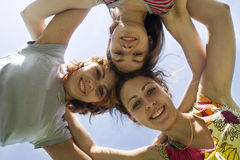 Three playmates. On the blue sky Stock Image