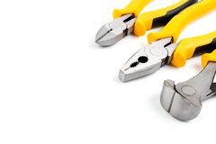 Three pliers is Nipper , Combination and Diagonal pliers. With yellow black handle comfort grip isolated on white background and have copy space Royalty Free Stock Image