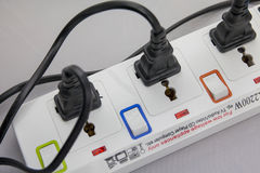 Three plugs plugged into electric power bar Stock Photos