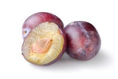Three plums Stock Photos