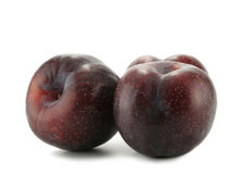 Three plums. Three big plums isolated over white background royalty free stock image