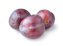 Three plums isolated Stock Photo