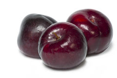 Three plums on white background. Royalty Free Stock Photography
