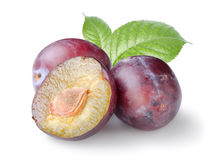 Three Plums With Leaves Royalty Free Stock Photo