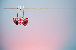 Three plush hearts on a blue background Royalty Free Stock Photos