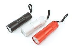 Three pocket flashlight torch Royalty Free Stock Photos