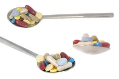Three point of view from teaspoon with pills Stock Image