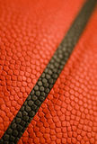 The Three Pointer. Closeup of a basketball showing texture detail Stock Photos