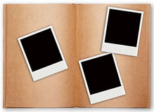 Three polaroid frame with old book open Royalty Free Stock Photo