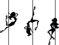 Three pole dancers Stock Photo