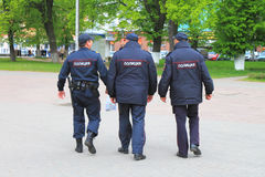 Three policemen, seen from behind Stock Image