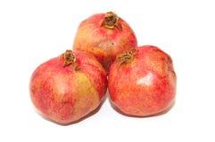 Three pomegranates Stock Photos