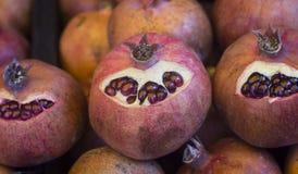 Three pomegranates. Bio Peeled pomegranate for sale in the market of chisinau Moldova royalty free stock photo