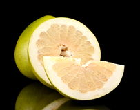 Three pomelos,half,quarter isolated on black Stock Images