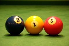 Three pool balls stock images