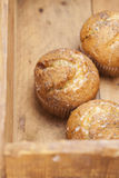 Three poppy seeds and lemon muffins in wooden box Royalty Free Stock Image