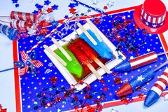 Three melting popsicles on patriotic background Royalty Free Stock Photo