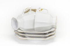 Three porcelain coffee cups lie on a pile of saucers Royalty Free Stock Image