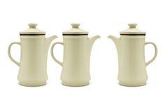 Three porcelain coffee pots Stock Photography