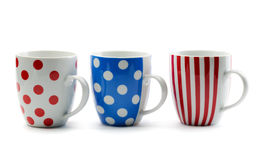 Three porcelain cup in colored stripes and dots Royalty Free Stock Image