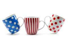 Three porcelain cup with stripes and dots Royalty Free Stock Images