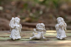 Three porcelain cupids figurines Royalty Free Stock Photography