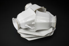 Three porcelain saucers and empty coffee cups stacked Royalty Free Stock Photos