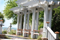 Three porch swings under an awning at Hilton Head, South Carolina. Royalty Free Stock Photography