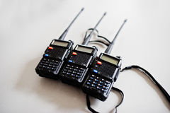 Three portable radio transmitter at steel background. Royalty Free Stock Image