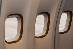 Three portholes of aircraft Stock Image