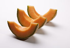 Three Portions of cantaloupe Royalty Free Stock Images