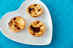 Three Portuguese Pastel de Nata on a Plate Stock Photography