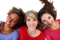 Three positive women. With heads down Royalty Free Stock Photo