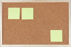Three post-it notes sticked on corkboard Royalty Free Stock Photos